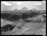 Construction site, Brighton Beach, Brooklyn, undated (ca. 1920). Roller coaster in background....
