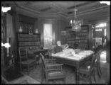 Interior view, Henry W. Merriam House, Newton, N.J., ca. 1911-1912. Library or office with elderly...