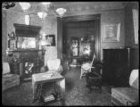 Interior view, Henry W. Merriam House, Newton, N.J., ca. 1911-1912. Empty room with fireplace and...
