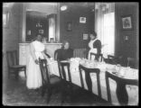 Unidentified Salvation Army officer and two female servants in the Salvation Army Home on Gramercy...