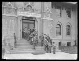 Boys in uniform with schoolbooks on the steps of the New York Parental School, Kissena Boulevard...