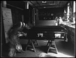 Attaching the extension handles of a casket, Oneida, N.Y., April 3, 1916. Photographed for the...