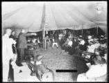 African-American nighttime tent revival meeting at 161st Street and Grant Avenue, Bronx, with the...