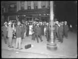 African-American group gathered on the corner of Lenox Avenue and W. 134th Street at night,...