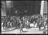Crowd listening to a street preacher at the intersection of Cedar Street and Broadway, New York...