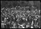 Crowd listening to unidentified man giving a speech, location unknown (New York City?), undated...