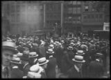 B.F. Butts waviing from the back of a car in Madison Square, New York City, September 23, 1914....