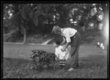 Clifford Moore (?) and William Gray Hassler with garden wheelbarrow, probably Inwood, New York...