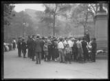 Crowd listening to unidentified couple giving a speech in Washington Square Park, New York City,...