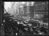 Afternoon crowds and traffic in Times Square, New York City, undated (ca. January 1917).