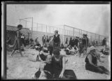 Beachgoers at Manhattan Beach handball (?) courts, Brooklyn, undated (ca. July 1917).