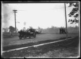 Cars on a rural road, possible heading to the Lorillard Spencer estate sale, Bronx, undated (ca....