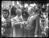 Al Smith shaking hands with unidentified (British?) official, probably New York City, undated (ca....