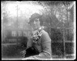 Odessa France Bjorkman in hat and corsage in the garden, undated (ca. 1925-1935).
