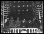 General John J. Pershing in the viewing stand with other military and civilian officials,...