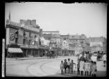 Children and old houses on Canal Street between Laight Street and Varick Street, New York City,...