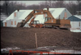 Remediation work ('clay capping') at Love Canal showing earthmoving equipment and abandoned 97th...