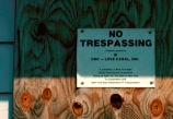 Close-up of 'No Trespassing' sign on abandoned Love Canal home