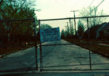 'Admittance by permit only' sign on gate into fenced-off Love Canal neighborhood