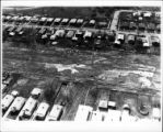 Aerial view of abandoned homes adjacent Love Canal site showing toxic waste rising to surface of...