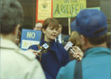 Protester being interviewed by the press at the rally against resettlement of the Love Canal area