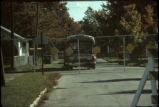 Abandoned and fenced-in Love Canal Ring 1 homes with emergency  evacuation bus