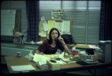 Lois Gibbs on the telephone at the Love Canal Homeowners Association Office inside the 99th Street...