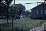 Abandoned and fenced-in Love Canal 99th Street, Ring 1 home immediately prior to demolition;...