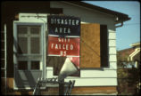 Protest sign on abandoned Love Canal home: 'Disaster area; City failed us'