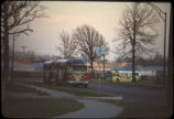 Emergency evacuation buses on 95th St. near Griffon Manor with abandoned 97th St. homes and the...