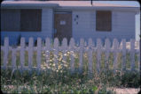 Abandoned Love Canal home with white picket fence