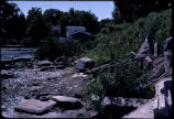 Debris-ridden shoreline of Niagara River upstream from Love Canal (south of canal and Frontier...