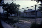 Abandoned and fenced-in Love Canal 99th Street, Ring 1 homes