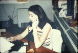 Lois Gibbs on the telephone at the Love Canal Homeowners' Association offices