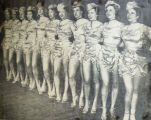 Chorus line of costumed dancers perform in the Junior League of Buffalo Follies of 1950 in the Erlanger Theater.