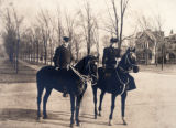 Doctor and Mrs. Lucien Howe on horseback on a Buffalo avenue