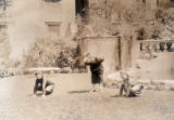 Children playing garden creatures crouch in the formal garden in the TCC production of  'A Pageant...