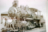 Railroad engine with five men