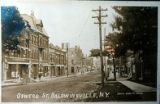 Postcard of Oswego Street with Howard Opera House
