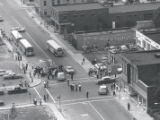 Aerial view of crowd at Joseph Avenue and Kelly Street after riot, Rochester, NY, 1964
