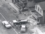 Aerial view of looted liquor store after riot, Rochester, NY, 1964