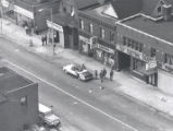 Aerial view of businesses along Clinton Avenue North after riot, Rochester, NY, 1964