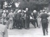 Police physically restrain unidentified person after riot, Rochester, NY, 1964