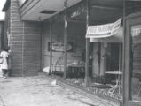 Debris in damaged storefront after riot, Rochester, NY, 1964