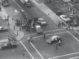 Aerial view of police and citizens gathered at intersection of Joseph Avenue and Kelly Street...