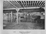 Car and charging station inside Washington DC garage, 1907