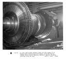 N.E. Masu, turbine bucket assembler, checks last stage assembly on low pressure turbine rotor...