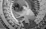 Louis Mazur and Richard Van Dyke, stator winders, check generator bar assembly on stator being...