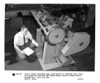 David W. Knight, development engineer, Baird Machine Co.,, Stratford, CT, checking finished part...