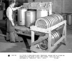 A.E. Delisle is shown making water, temperature, impeller test on finished egg washer used General...